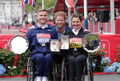 David Weir and Manuela Schar collecting London Marathon medals from Prince Harry
