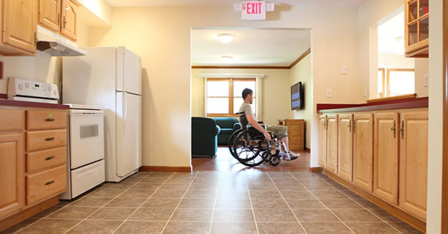 Wheelchair user in his kitchen